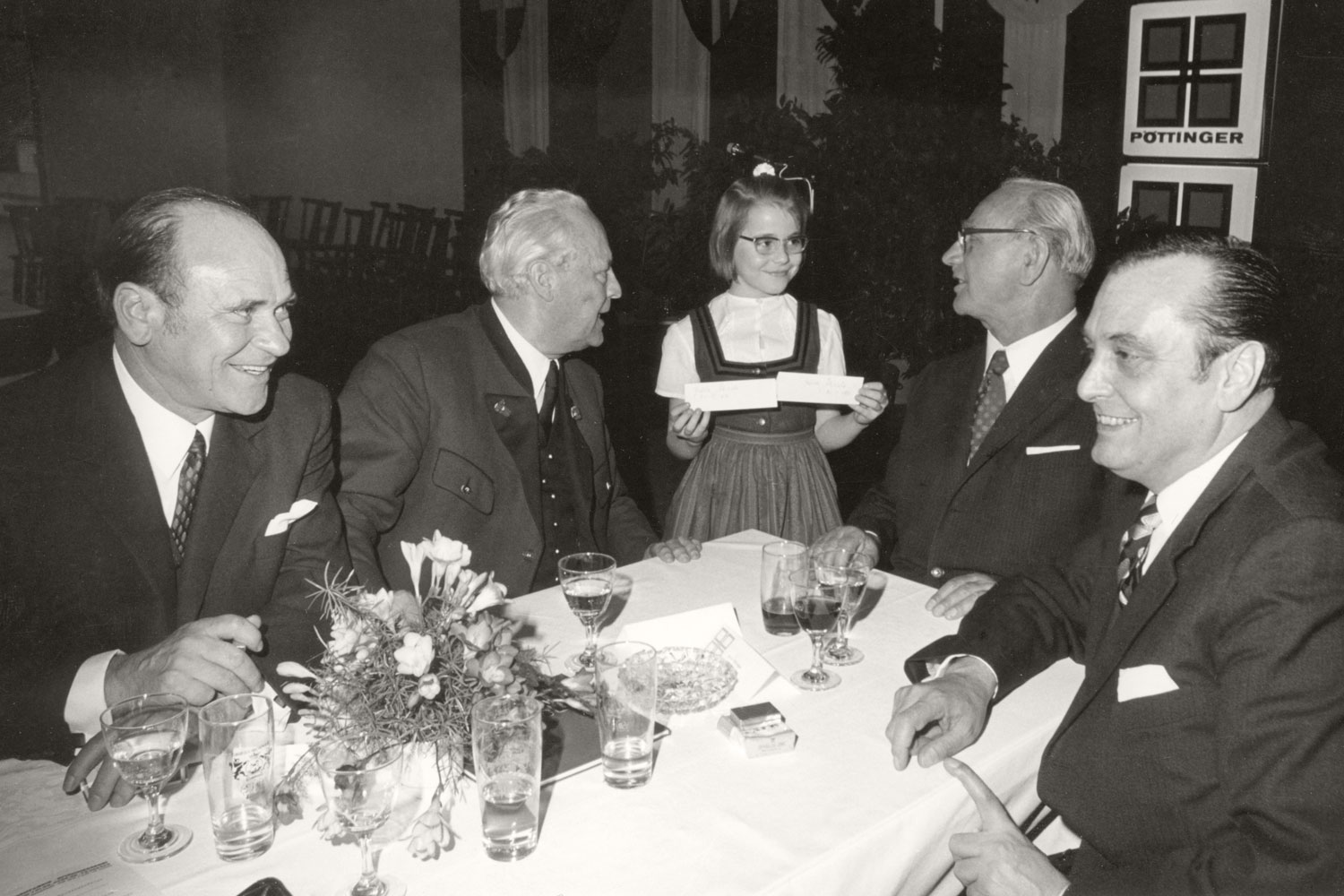 President Franz Jonas (second from the right) pays attention to the little lady at the table.