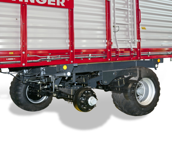 Suspended tandem axle with parabolic springs