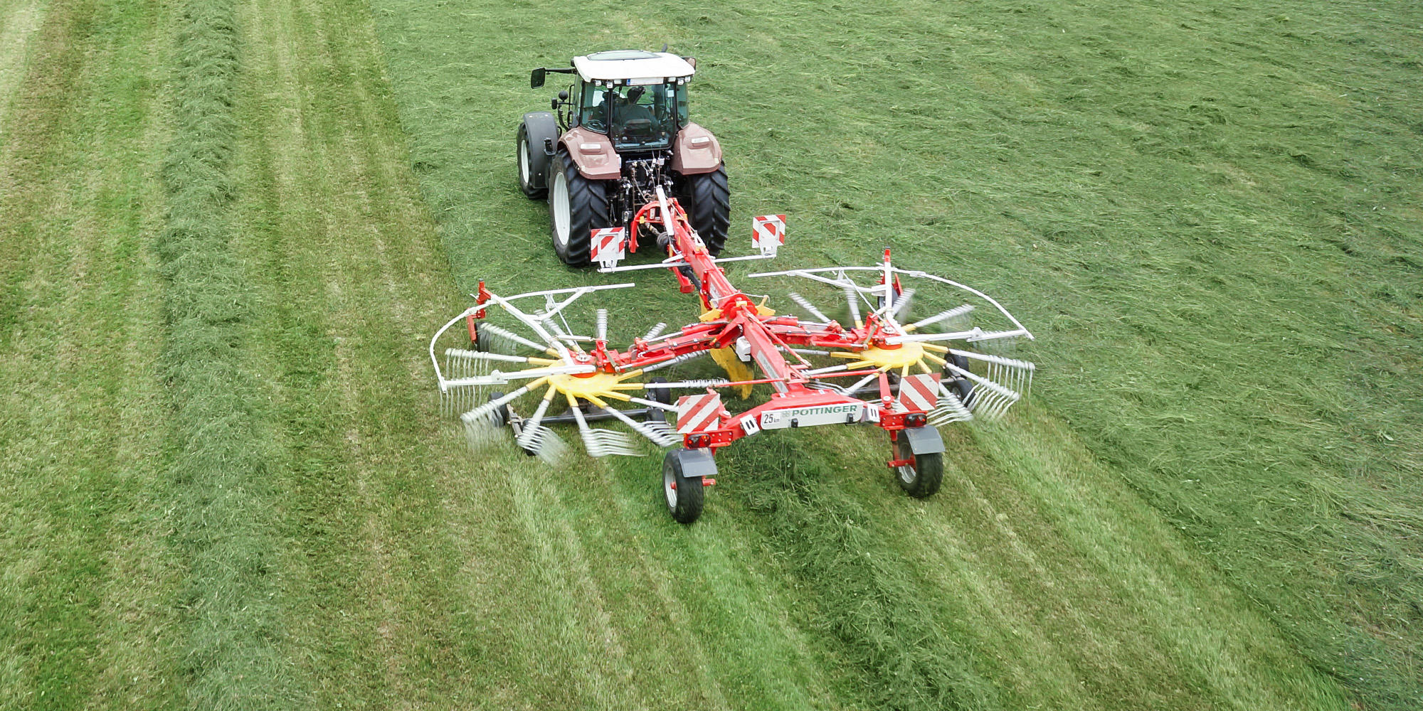 TOP C twin rotor, centre swath rakes